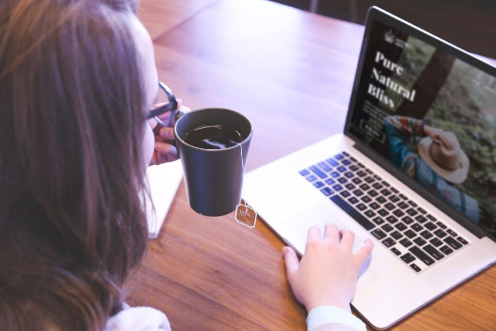 Woman on computer ordering Mothers Hemp